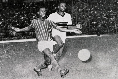 Joseph Bléziri of Stade d'Abidjan (left) passes the ball into the box.